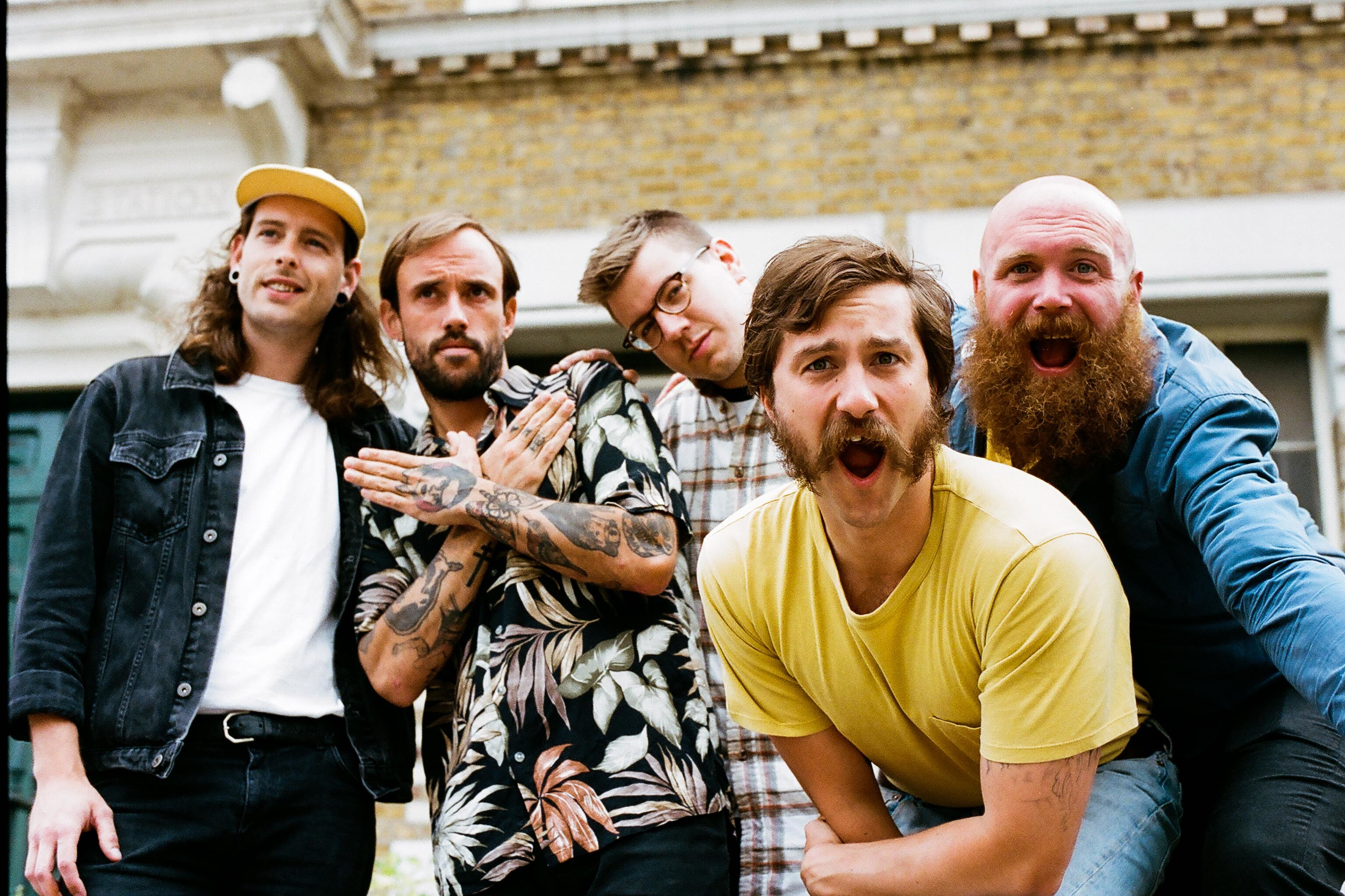 IDLES get animated in new 'Never Fight A Man With A Perm' video
