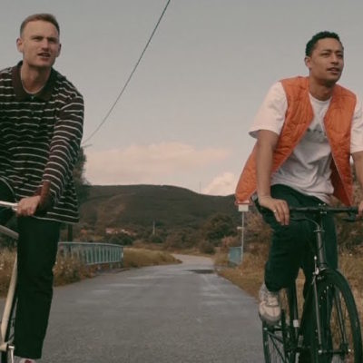 Loyle Carner and Tom Misch get on their bikes in new 'Angel' video