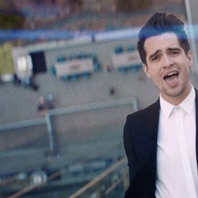 Brendon Urie scales a skyscraper in Panic! At The Disco's new video for 'High Hopes'
