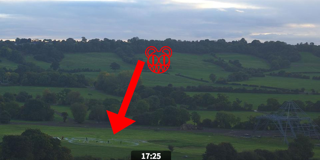 Radiohead's bear logo is being drawn next to the Glastonbury Pyramid Stage right now