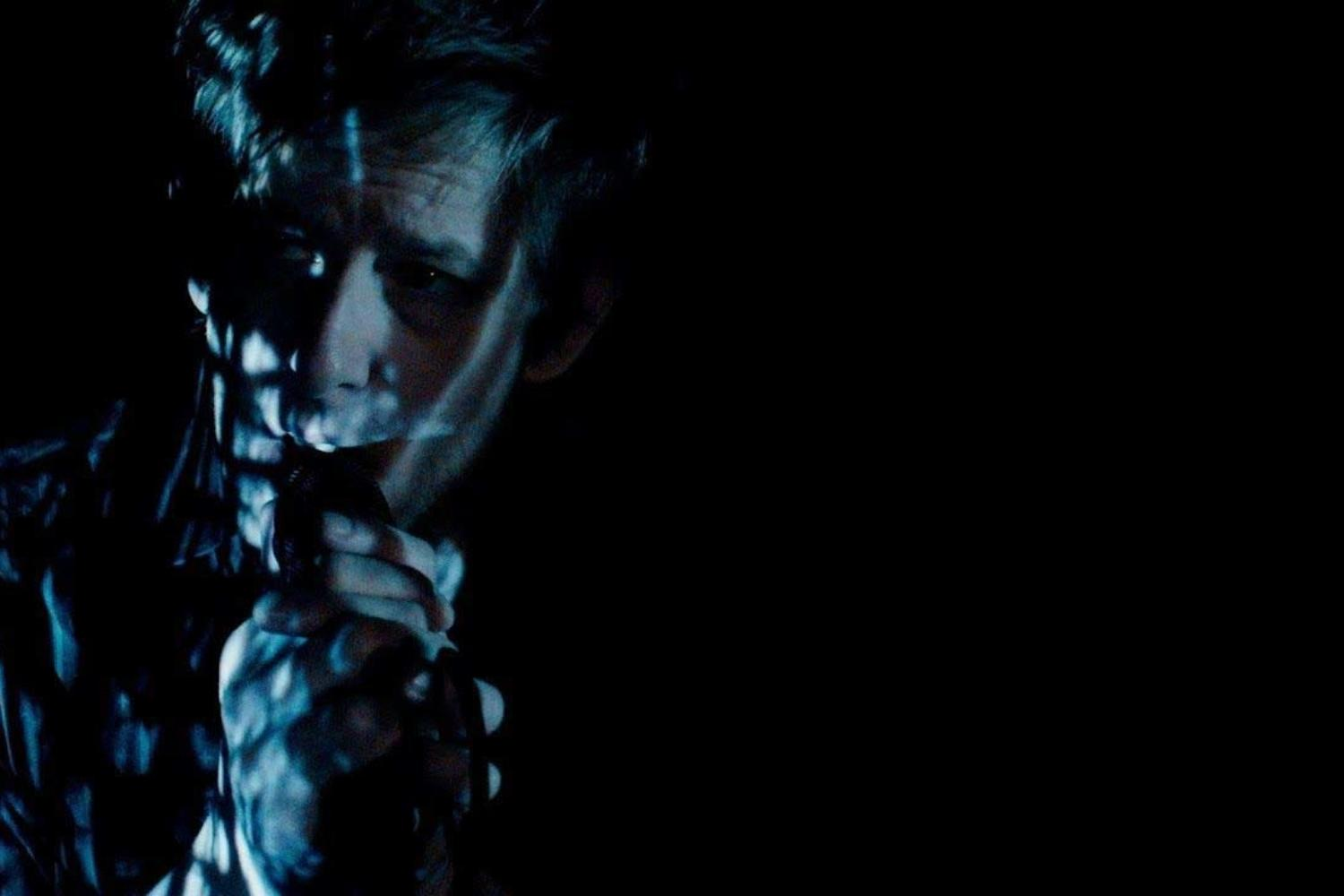 Spoon hide in the shadows in their 'I Ain't The One' video